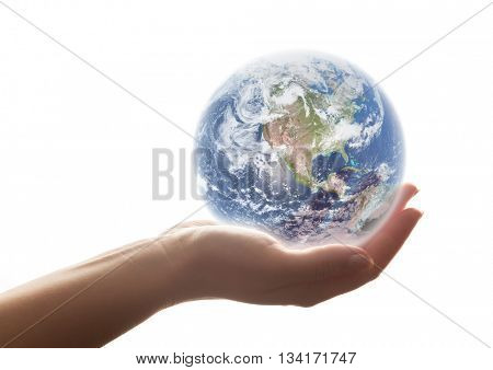The earth shines in woman's hand. Strong backlight, isolated on white. Concepts of save the world, protection, taking care, environment. Elements of this image furnished by NASA