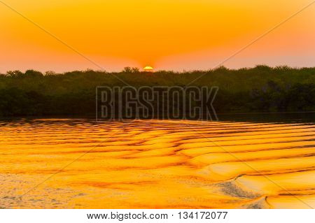Colorful Sunrise Over Island In Galapagos
