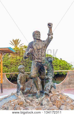 Puerto Ayora Galapagos Ecuador - April 6 2016: Sculpture dedicated to fruits of the sea tu fruto tu mar is located in the city of Puerto Ayora on Santa Cruz island in Galapagos