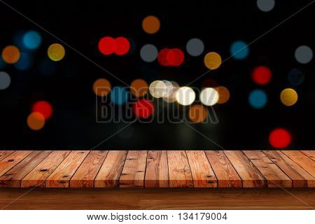 Empty wooden table with bokeh abstract light background. For display or montage your products.