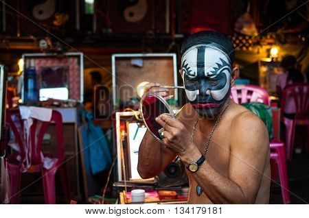 BANGKOK, THAILAND - JANUARY 17: A Chinese actor is doing make up before the show of traditional Chinese opera on January 17, 2015 in Bangkok, Thailand.