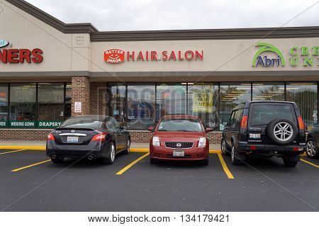 JOLIET, ILLINOIS / UNITED STATES - OCTOBER 9, 2015: The Better Image Hair Salon offers men's haircuts for $10 on Tuesdays and Wednesdays, in the Crossroads Plaza.