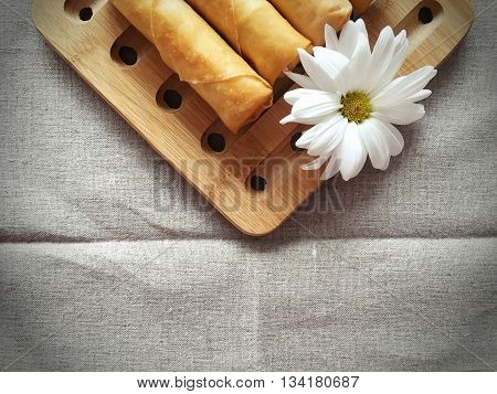 Homemade deep Frying Spring Rolls with white daisy