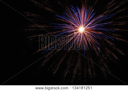 Large purple and orange firework at 4th of July