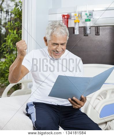 Successful Senior Man Looking At Reports In Rehab Center