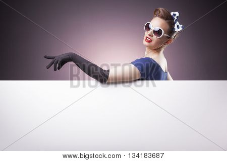 Beautiful Pin Up girl holding a white board