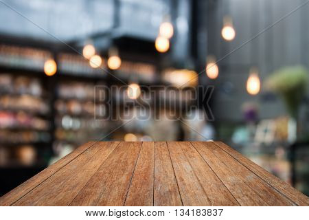 Perspective wooden on coffee shop blurred background with bokeh, stock photo