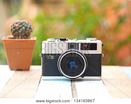 Vintage old camera with camera on the old wooden, focus camera