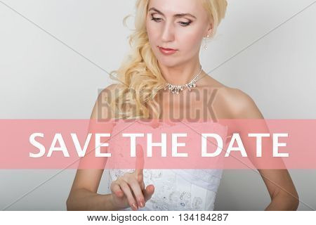 technology, internet and networking concept. Beautiful bride in fashion wedding dress. Bride presses save the date button on virtual screens.