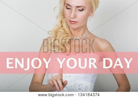 technology, internet and networking concept. Beautiful bride in fashion wedding dress. Bride presses enjoy your day button on virtual screens.