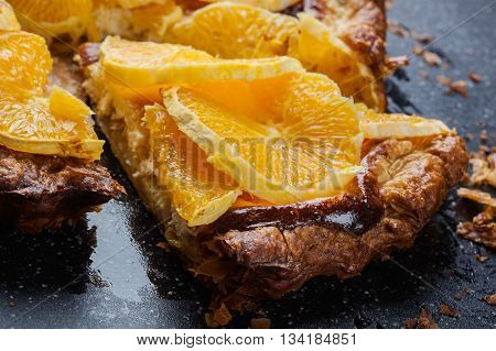 Slice Of Tart With Cheese And Sliced Orange