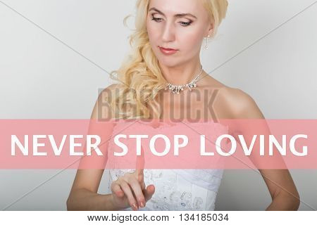 technology, internet and networking concept. Beautiful bride in fashion wedding dress. Bride presses never stop loving button on virtual screens.