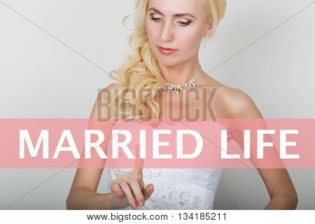 technology, internet and networking concept. Beautiful bride in fashion wedding dress. Bride presses married life button on virtual screens.