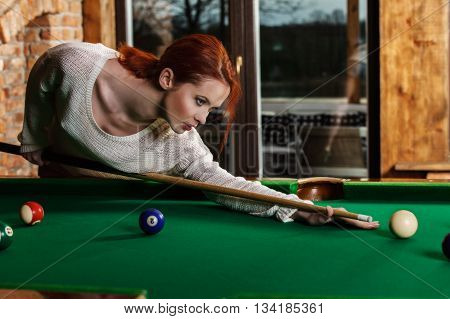 Attractive Woman Plays The Game Of Snooker Pool Table