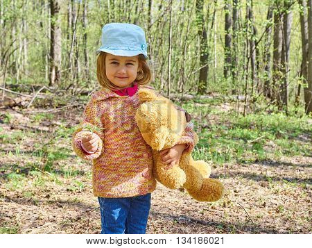 Girl With Teddy Bear Gives Yellow Flower.