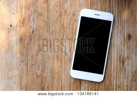 White color smartphone on the   wooden background