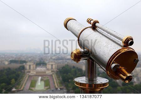 PARIS, FRANCE - JUNE 8, 2013:Spyglass on the Eiffel Tower