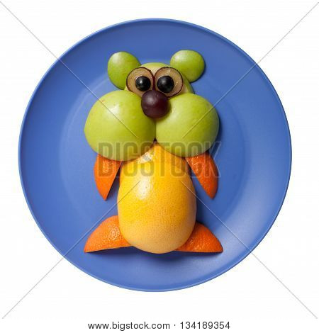 Hamster made of fruits on blue plate