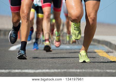Marathon running race, runners feet on road poster