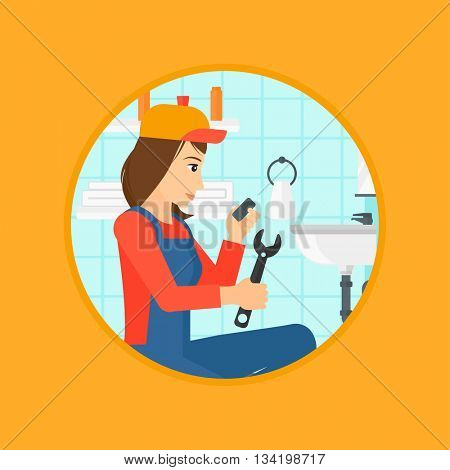A female plumber sitting in a bathroom and repairing sink pipe. Plumber with wrench repairing a broken sink in bathroom. Vector flat design illustration in the circle isolated on background.