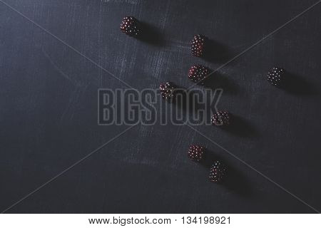 Fresh blackberries on scratched chalk blackboard flat lay