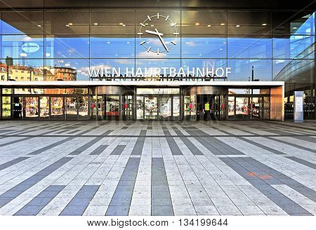 VIENNA AUSTRIA - JUNE 6: Main railway station of Vienna with the german sign «Vienna train station» on June 6 2016. Vienna is the capital and largest city of Austria.