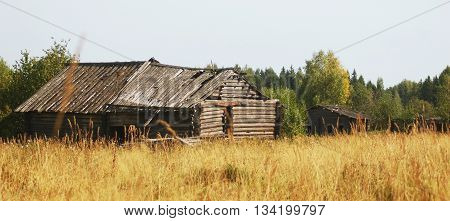 Old abandoned house in the middle of Golden fields