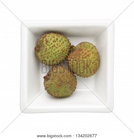 Green lychees in a square bowl isolated on white background