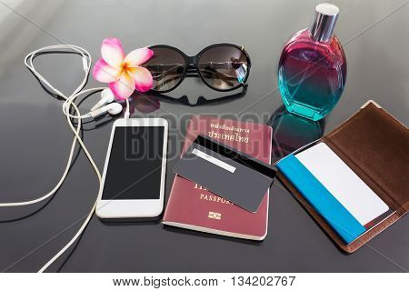 Blank or empy credit or debit card and smartphone with background of perfume sunglasses flower blank business card and passport