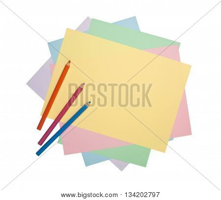 Color pencils and colorful paper isolated on white background