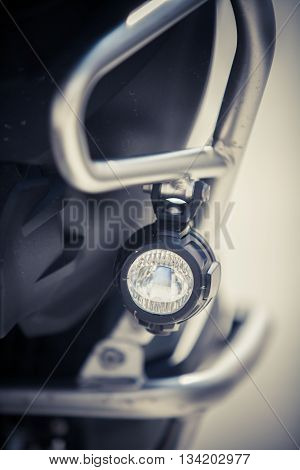 Close up image of a fog light from a motorcycle.