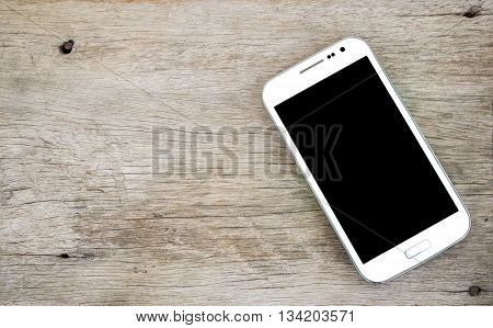 White Smart phone on old wood background.