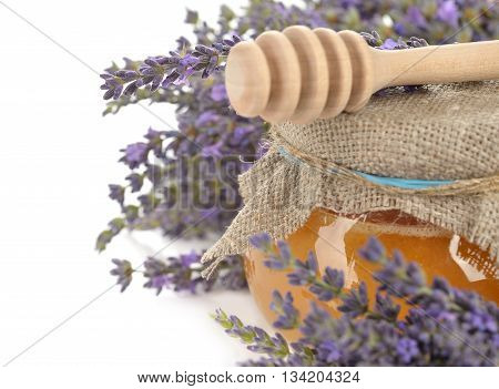 Lavender honey on a white background close up