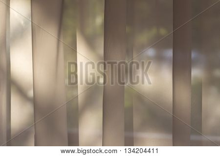Soft beige background as net curtains on the window