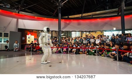 TOKYO JAPAN - NOVEMBER 27 2015: Asimo the humanoid robot created by Honda is presented at Miraikan The National Museum of Emerging Science and Innovation in Odaiba area