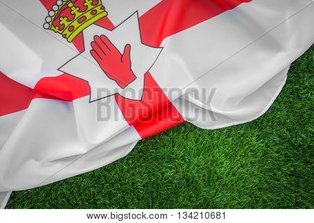 Flags of Northern Ireland on green grass