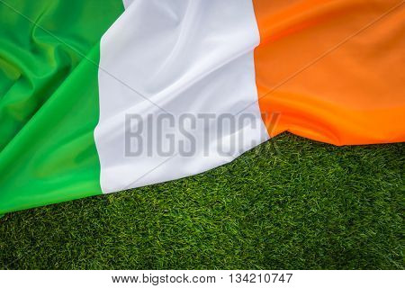 Flags of Republic of Ireland on green grass