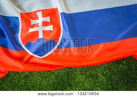 Flags of  Slovakia on green grass
