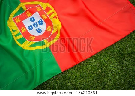 Flags of Portugal on green grass