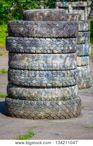 hiding place - barricade for paintball players made of old tires with paint marks after fights