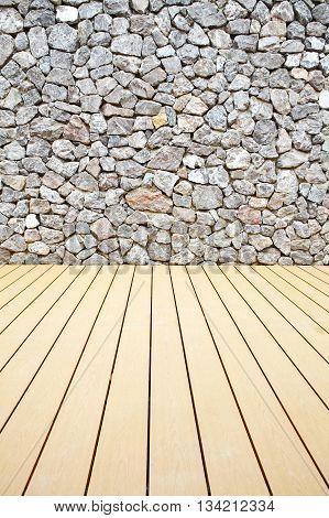 Wooden floor and stone walls backgroundThe rock walls and wooden floor.