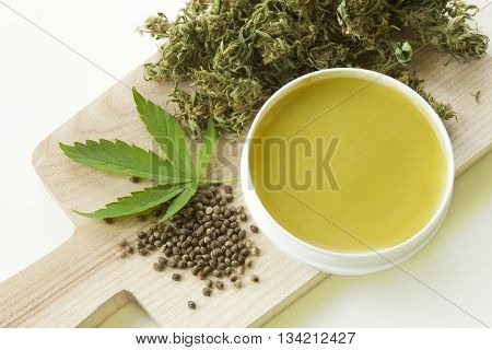 Cannabis healing ointment and marijuana green leaf and seeds