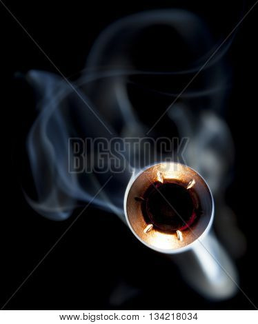 Hollow point bullet in copper and lead with smoke coming close