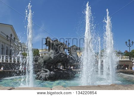 """MOSCOW, RUSSIA - MAY 31, 2016: A view of the fountain and the sculpture composition """"The Four Seasons"""" Manezhnaya Square landmark"""