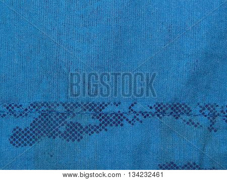 blue cloth with abstract drawings of dots with delayed suture of thread