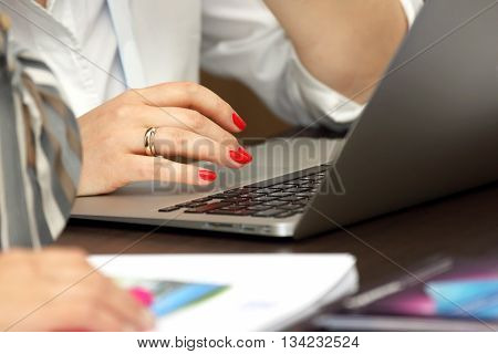 hands of business woman working on laptop