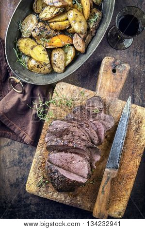 Barbecue Roast Venison with Potatoes and Quince