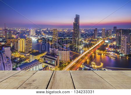 wooden plank with cityscape view of bangkok city
