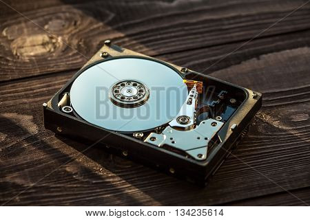 Disassembled Hdd On The Wooden Rustic Background Close-up Shot