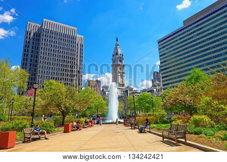 Philadelphia, USA - May 5, 2015: Love Park with Fountain and Philadelphia City Hall on the background. Tourists in the park. Pennsylvania USA.